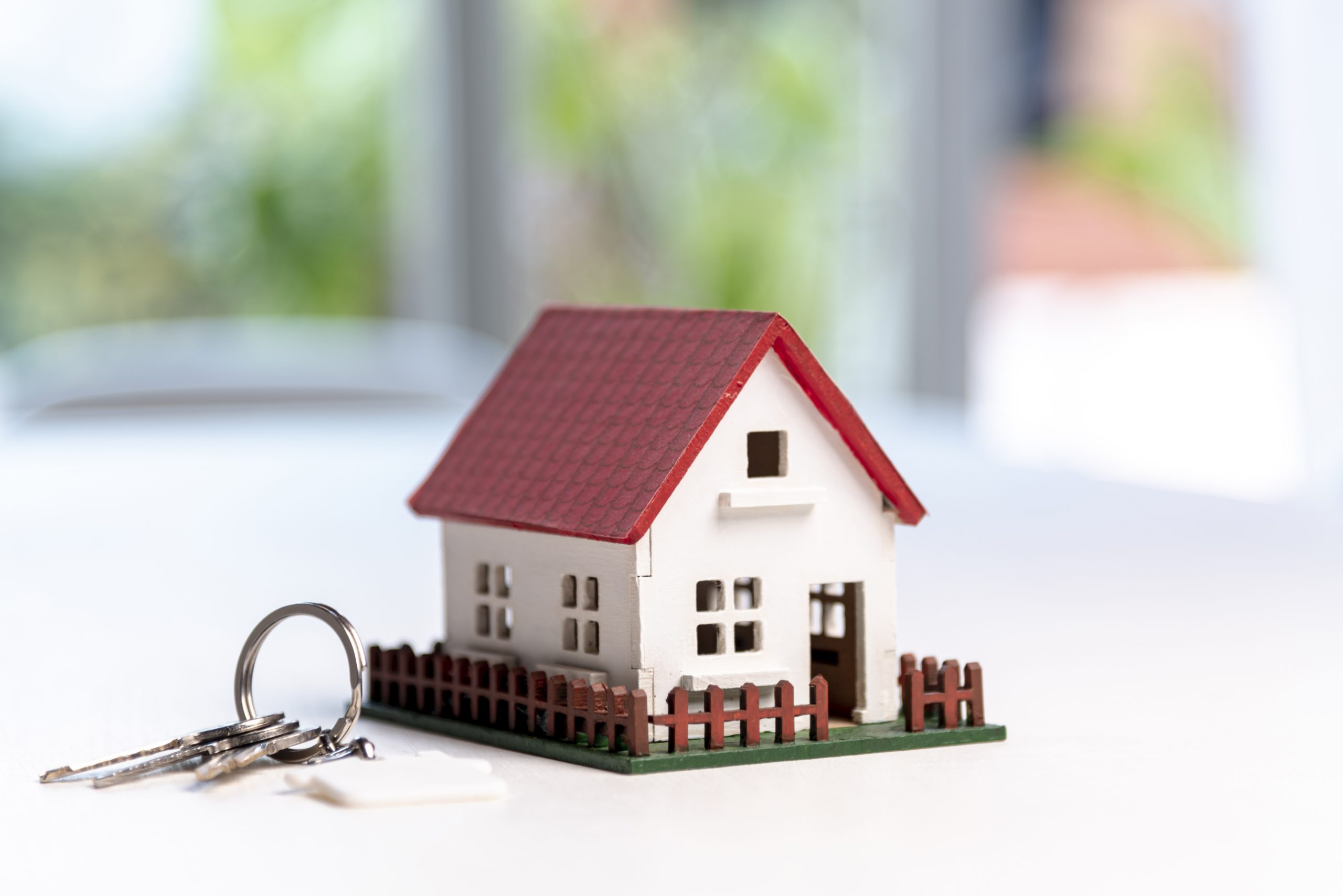 Model house and keys beside it