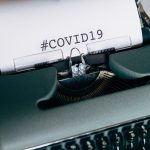 Typewriter with COVID19 written on paper
